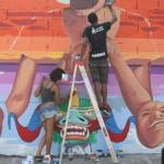 Artistas plásticos rompen silencio de paredes de La Vega en Muralizando RD